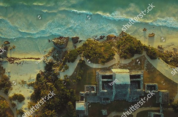 stock-photo-tulum-maya-temple-ruin-drone-birds-eye-view-by-drone-in-mexico-at-sunrise-1306813777